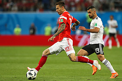 June 19, 2018 - Saint Petersburg, Russia - Fedor Smolov (L)  of the Russia national football team vie for the ball during the 2018 FIFA World Cup match, first stage - Group A between Russia and Egypt at Saint Petersburg Stadium on June 19, 2018 in St. Petersburg, Russia. (Credit Image: © Igor Russak/NurPhoto via ZUMA Press)