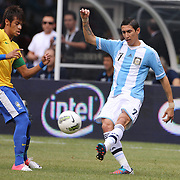 Angel Di Maria, Argentina, (right) passes past Neymar, Brazil, during the Brazil V Argentina International Football Friendly match at MetLife Stadium, East Rutherford, New Jersey, USA. 9th June 2012. Photo Tim Clayton