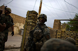 Soldiers with Charlie Co. 1-26 Infantry 1st Infantry Division carry out the routine search of a block of homes in Adhamiya on Thursday April 27, 2007.