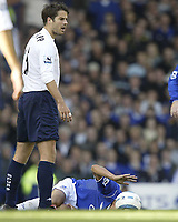 Fotball<br /> Premier League 2004/2005<br /> Foto: SBI/Digitalsport<br /> NORWAY ONLY<br /> <br /> Everton v Tottenham Hotspur<br /> Barclays Premiership.<br /> 03/10/2004.<br /> <br /> Spurs Jamie Redknapp stands above Everton's Tim Cahill after a very bad challenge that ment Cahill had to leave the field