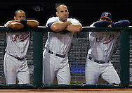 MORNING JOURNAL/DAVID RICHARD<br />Cleveland Indians Coco Crisp, from left, Travis Hafner and Fernando Cabrerra watch from the dugout as teammate Victor Martinez strikes out in the eighth inning during Tuesday night's Tribe loss to Tampa BAy.