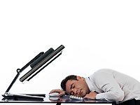 one caucasian business man using computer sleeping in studio indoors isolated on white background