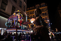 """LYON, FRANCE - DECEMBER 07:Festival of Lights on December 7, 2013 in Lyon. <br /> Parade of giant puppets inspired by the Mexican Alebrijes, chimeras of paper mache or carved wood<br /> Spectacular light works by 120 designers will be on show over four days along will attract some three million visitors to the historic city.<br /> In france, each year on December 8, The Festival of Lights expresses gratitude toward Virgin Mary<br /> According to the people, the Festival of Lights celebrates Mary who stopped plague in 1643. The municipal councillors (échevins) had promised to pay tribute to Mary if she saved the town<br /> Since this year, a solemn procession makes its way to the Basilica of Fourvière to candles light and gives offerings in the name of Mary. <br /> This lyonnaise tradition dictates that everyone places candles outsides on all the windows to produce a spectacular effect throughout the streets. Each year, over 4 million tourists come to Lyon for this event.<br /> This festival is probably one of the three biggest festive gatherings in the world in terms of attendance.<br /> And through time, this act of faith in Lyon has been perpetuated by all families and in all religions.<br /> <br /> It is a gesture of joy and gratitude.<br /> Nothing obliges people of Lyon to put these small candles but many of them, away from home, in Paris, Rome, Hong Kong or New York, on December 8, will put in a glass a piece of candle on the edge of their windows, and will think """"I'm from Lyon too.""""<br /> Bruno Vigneron/Getty Images)"""