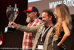 Verner Ortis of VM Cycles in Tolmezzo, Italy, is actually a metal worker specializing in stairs and gates for homes, but this didn't stop him from winning first place in the retro Modified class with his custom 1942 Harley-Davidson WLA in the AMD World Championship of Custom Bike Building awards ceremony in the Intermot Customized hall during the Intermot International Motorcycle Fair. Cologne, Germany. Sunday October 7, 2018. Photography ©2018 Michael Lichter.