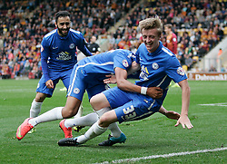 Chris Forrester of Peterborough United (right) is mobbed by team-mates after scoring to make it 2-0 - Mandatory byline: Joe Dent/JMP - 07966386802 - 26/09/2015 - FOOTBALL - Coral Windows Stadium -Bradford,England - Bradford City v Peterborough United - Sky Bet League One