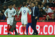 Gareth Southgate, the England interim manager congratulates Jamie Vardy of England as he replaced. England v Spain, Football international friendly at Wembley Stadium in London on Tuesday 15th November 2016.<br /> pic by John Patrick Fletcher, Andrew Orchard sports photography.