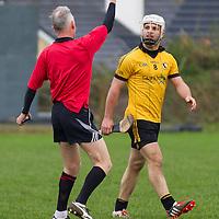 Clonlara's Cormac O'Donovan receives a warning from referee Ambrose Heagney