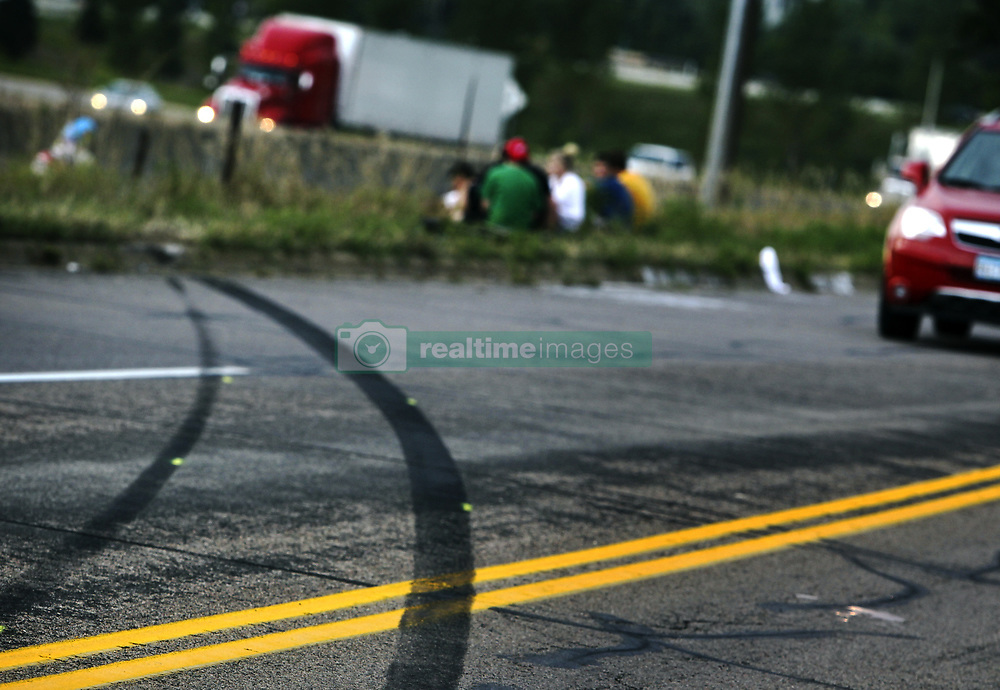 Aug. 22, 2012 - Burnsville, MN, U.S. - Tire skid marks are visible off of Buck Hill Road where classmates and friends of Frederick J. Alexander, 16, of Burnsville, and Alesha K. Roehl, 17, of Northfield, who were killed in a car accident Tuesday afternoon after the car five of them were riding in sped off a Burnsville frontage road, rolled over and wound up on Interstate 35, gathered near the crash site Wednesday, August 22, 2012, in Burnsville, MN. Weeks after three teens died in a crash on I-94, apparently while horsing around, a car loaded with five teens -- which witnesses said was speeding and swerving -- rolled off a frontage road in Burnsville and ended up in the southbound lanes of I-35, killing two passengers and injuring the other three teens on Tuesday. (Credit Image: © TNS via ZUMA Wire)