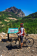Mountain biker and interpretive sign on the Galloping Goose Trail, Uncompahgre National Forest, Colorado USA (MR)