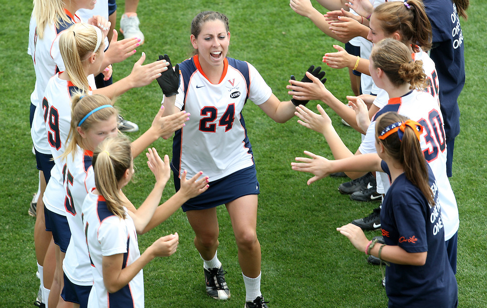 The University of Virginia women's lacrosse player Nikki Cory runs through the huddle at the start of their first game since the tragic death of teammate Yeardley Love Sunday May 16, 2010 at Klockner Stadium in Charlottesville, Va. The Cavaliers rallied in the last four minutes to beat Towson 14-12 and reach the quarter finals of the NCAA tournament. Love's body was found May 3, and Virginia men's lacrosse player George Huguely is charged with murder. Photo/Andrew Shurtleff..