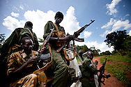 SPLA soliders load their guns before escorting an Aid convoy through an area recently attacked by the LRA. South Sudan's inability to secure much of the region from internal militias, tribal conflicts, and outside forces like the LRA has made development difficult as peace looks increasingly like a hope, rather than a reality.