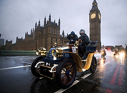 © London News Pictures. 04/11/2012. London, UK.  Vehicles cross Westminster Bridge in London with Britain's Houses of Parliament and Big Ben in the background during the 2012 London to Brighton Veteran Car Run on November 4, 2012.  Over 500 vehicles built before 1905 take part in the annual run which attracts competitors from all over the world. Photo credit: Ben Cawthra/LNP.