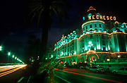 Exterior of the Cote d'Azur's Hotel Negresco on the Promenade de Anglais, on 10th May 1996, in Nice, France. The Hotel Negresco on the Promenade des Anglais on the Baie des Anges in Nice, France was named for Henri Negresco (1868-1920) who had the palatial hotel constructed in 1912. Noted for its doormen dressed in the manner of the staff in 18th-century elite bourgeois households, complete with red-plumed postilion hats, the hotel also offers renowned gourmet dining at Le Chantecler. In 2003 the Hotel Negresco was listed by the government of France as a National Historic Building. (Photo by Richard Baker / In Pictures via Getty Images)