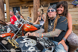 Jack Kowalchik of Albany, New York with Hilary Golida of Hill City, SD at the Spur Creek Ranch north of Sturgis during a stop for food and cowboy games on the annual Michael Lichter - Sugar Bear Ride hosted by Jay Allen from the Easyriders Saloon during the Sturgis Black Hills Motorcycle Rally. SD, USA. Sunday, August 3, 2014. Photography ©2014 Michael Lichter.