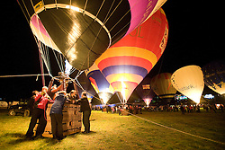 © Licensed to London News Pictures. 11/08/2011. Bristol, UK. The 'Night Glow' and firework display finale to the first day of the 2011 Bristol Balloon Fiesta today (11/08/2011) in which 30 hot air balloons glow in time to music. Photo credit: Ben Cawthra/LNP