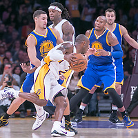 16 November 2014: Los Angeles Lakers guard Kobe Bryant (24) drives past Golden State Warriors guard Klay Thompson (11) on a screen set by Los Angeles Lakers center Jordan Hill (27) during the Golden State Warriors 136-115 victory over the Los Angeles Lakers at the Staples Center, Los Angeles, California, USA.
