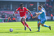 Mamadou Thiam of Barnsley (26) and Liam Kelly of Coventry City (6) in action during the EFL Sky Bet League 1 match between Barnsley and Coventry City at Oakwell, Barnsley, England on 30 March 2019.