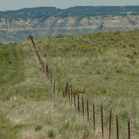 A fence divides pastures on the PN Ranch in the Upper Missouri River Breaks of central Montana.