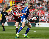 Paul Coutts of Sheffield Utd in action with Dan Gardner of Chesterfield during the English League One match at  Bramall Lane Stadium, Sheffield. Picture date: April 30th 2017. Pic credit should read: Simon Bellis/Sportimage