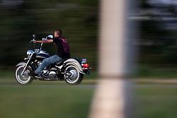 A man rides his chopper down the freeway
