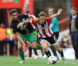 Scott Golbourne of Bristol City challenges for the ball with Sam Saunders of Brentford - Mandatory by-line: Dougie Allward/JMP - 16/04/2016 - FOOTBALL - Griffin Park - Brentford, England - Brentford v Bristol City - Sky Bet Championship