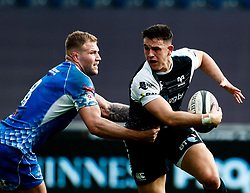 Owen Watkin of Ospreys under pressure from Ross Moriarty of Dragons<br /> <br /> Photographer Simon King/Replay Images<br /> <br /> Guinness PRO14 Round 18 - Ospreys v Dragons - Saturday 23rd March 2019 - Liberty Stadium - Swansea<br /> <br /> World Copyright © Replay Images . All rights reserved. info@replayimages.co.uk - http://replayimages.co.uk