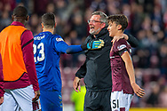 Heart of Midlothian manager Craig Levein hugs his players after Hearts win the penalty shoot out at the end of Betfred Scottish Football League Cup quarter final match between Heart of Midlothian FC and Aberdeen FC at Tynecastle Stadium, Edinburgh, Scotland on 25 September 2019.