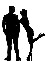 one caucasian couple lovers  woman wanting to kiss the man in studio silhouette isolated on white background