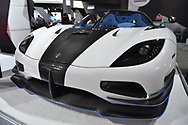 Manhattan, New York, USA. April 12, 2017.  Koenigsegg Agera RS, white and black with alcantara blue interior, is on display in the Exotics car section at the New York International Auto Show, NYIAS, during the first Press Day at the Javits Center. Only 25 Koenigsegg Agera RS sports cars will be produced in this exclusive series by the Swedish company.