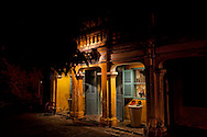 Small shop facade illuminated at night in Hoi An, Vietnam, Southeast Asia