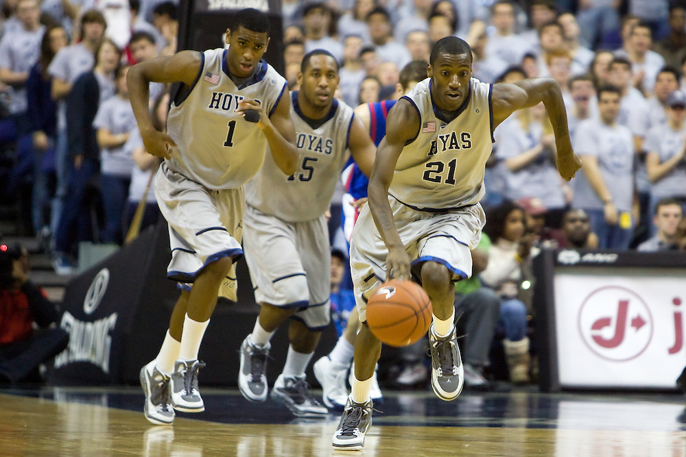 WASHINGTON - DECEMBER 5: Jason Clark #21 of the Georegtown Hoyas drives the basket during a college basketball game against the American Eagles on December 5, 2009 at Verizon Center in Washington DC.