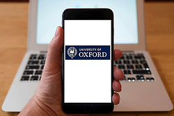 Using iPhone smartphone to display logo of the University of Oxford