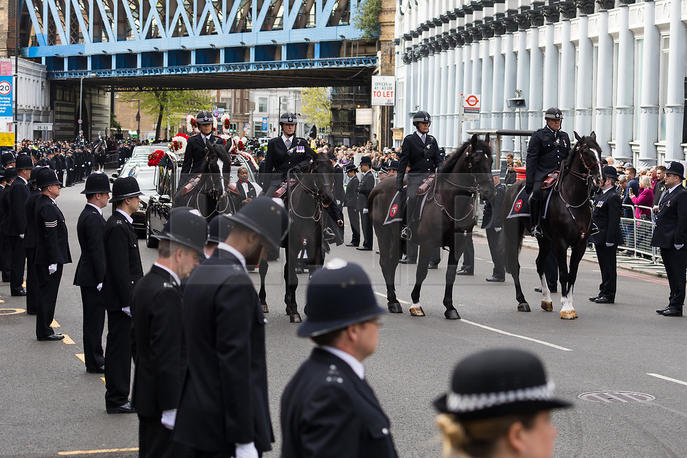 © Licensed to London News Pictures. 10/04/2017. LONDON, UK. The procession and funeral cortege of PC Palmer outside Southwark Cathedral in London, where a full police funeral takes place this afternoon. <br /> PC Keith Palmer was stabbed to death whilst on duty in Westminster by terrorist extremist Khalid Masood last month.  Photo credit: Vickie Flores/LNP