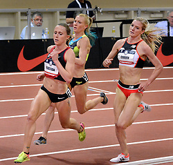 February 17, 2018 - Albuquerque, NM, U.S. - left to right- Shelby Houlihan takes the lead for the win on the final lap against Katie Mackey and Emma Coburn in the women's 3000 meter run at the USATF Indoor Championships. Saturday, Feb. 17,  2018. (Credit Image: © Jim Thompson/Albuquerque Journal via ZUMA Wire)