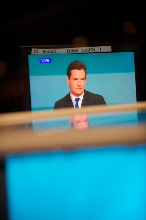 Television monitors within the BBC studios reflect the speech of the Chancellor of the Exchequer George Osborne on the second day of the Conservatives Party Conference at the ICC, Birmingham, UK on October 4, 2010.  This is the first conference since the government coalition with the Liberal Democrats.