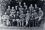 Cavendish Laboratory, Cambridge, England: research students, 1898.  J(oseph) J(ohn) Thomson (1856-1940) is in the centre of the front row with his arms crossed. In the middle row are C(harles) T(homson) R(ees) Wilson and Ernest Rutherford (1871-1937), 3rd and 4th from left respectively.  From 'Recollections and Reflections' by JJ Thomson (London, 1936).