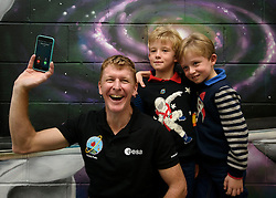 The phone rings as British astronaut Tim Peake takes a selfie with eight-Year-old twins Conor (right) and Greg Wardlaw during a visit to Clyde Space in Glasgow, where he took part in a Q & A with children from from Baljaffray Primary School and Bearsden Academy.