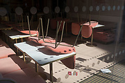 Fading restaurant seating remains on tables in the West End of London, on the day that UK Prime Minster, Boris Johnson announced in parliament a major easing of Coronavirus pandemic restrictions on July 4th next week, including the re-opening of pubs, restaurants, hotels and hairdressers in England, on 23rd June 2020, in London, England. The three month two metre social distance will be also reduced to one metre plus but in the last 24hrs, a further 171 have died from Covid, bringing the UK total to 42,927.