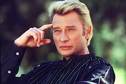 File photo : File photo of French singer and actor Johnny Hallyday (born Jean-Philippe Smet; 15 June 1943) pictured in November 1986 . France's biggest rock star Johnny Hallyday has died from lung cancer, his wife says. He was 74. The singer - real name Jean-Philippe Smet - sold about 100 million records and starred in a number of films. Photo by Calo-MF/ABACAPRESS.COM