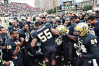NASHVILLE, TN - OCTOBER19:  Caleb Azubike #55 and teammates of the Vanderbilt Commodores celebrate after a win against the Georgia Bulldogs at Vanderbilt Stadium on October 19, 2013 in Nashville, Tennessee.  The Commodores defeated the Bulldogs 31-27.  (Photo by Wesley Hitt/Getty Images) *** Local Caption *** Caleb Azubike Sports photography by Wesley Hitt photography with images from the NFL, NCAA and Arkansas Razorbacks.  Hitt photography in based in Fayetteville, Arkansas where he shoots Commercial Photography, Editorial Photography, Advertising Photography, Stock Photography and People Photography