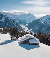 Aerial View of Snowy Mountain Chalet in Glarus in Winter