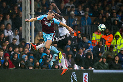 Sam Vokes of Burnley beats Timothy Fosu-Mensah of Fulham to the ball - Mandatory by-line: Robbie Stephenson/JMP - 26/08/2018 - FOOTBALL - Craven Cottage - Fulham, England - Fulham v Burnley - Premier League