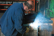 Metal workshop production line Manufacturing a truck cart welding the pieces together