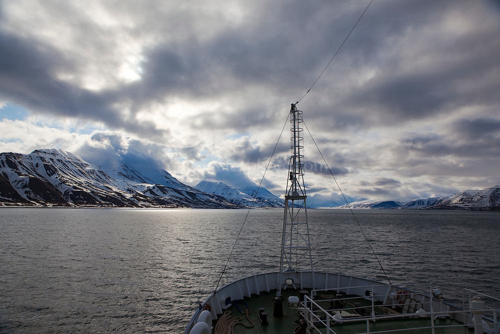 A ship in Adventfjorden, approaching the port of Longyearbyen, Spitsbergen, in the Arctic archipelago of Svalbard.