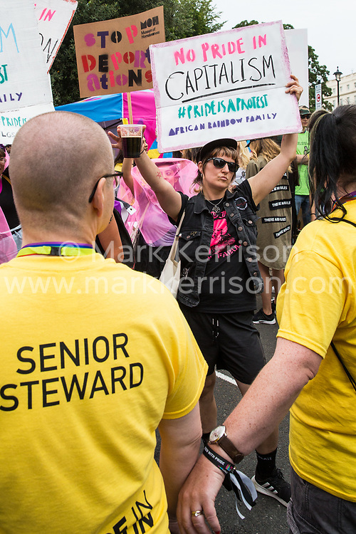 London, UK. 6 July, 2019. Pride in London stewards form a cordon to prevent activists from Lesbians and Gays Support The Migrants, African Rainbow Family, the Outside Project, Micro Rainbow and many other LGBT+ groups from joining Pride in London. The activists broke through the cordon and joined the rear of the march behind a line of stewards and police officers, marching in solidarity with those for whom Pride in London is inaccessible and in protest against the corporatisation of Pride in London.