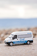 EMBARGOED 00:01 Wednesday 22nd February; 2017.<br /> <br /> A miniature Oomph! minibus on the seafront in Southsea, Hampshire. 100,000s of old and vulnerable people will enjoy new Out and About excursions after Oomph! announces nationwide expansion plans today (Wednesday 22nd February).<br /> Out and About tackles a lack of outings for people in care settings due to social care funding cuts. Innovative model offers economies of scale on excursion planning, transport and conductors across care settings in an area.<br /> 80 Out and About minibuses will hit the road in first year thanks to £1.5million investment from Mike Parsons, Care and Wellbeing Fund and Nesta Impact Investments.<br /> Photograph by Christopher Ison ©<br /> 07544044177<br /> chris@christopherison.com<br /> www.christopherison.com