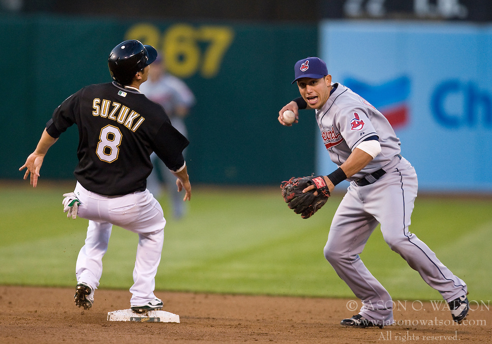 April 23, 2010; Oakland, CA, USA;  Cleveland Indians shortstop Asdrubal Cabrera (13) completes a double play after tagging Oakland Athletics catcher Kurt Suzuki (8) out at second base during the second inning at Oakland-Alameda County Coliseum. Oakland defeated Cleveland 10-0.