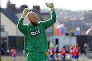 Dagenham's goalkeeper Mark Cousins celebrates in front of the travelling fans as his side score their second goal. Skybet football league two match , Newport county v Dagenham & Redbridge at Rodney Parade in Newport, South Wales on Saturday 18th April 2015.<br /> pic by David Richards, Andrew Orchard sports photography.