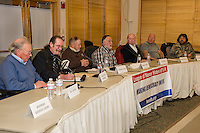 Bev Lapham, Jr, David Lund Bennett, Sr, L. Michael Hatch, Jonathan James, Ray A. Moritz, Michael J. Pelczar and Roland Tichy answer questions from voters during the candidates forum at Meredith Community Center Thursday evening.    Not present Rosemary Kiernan Landry.  (Karen Bobotas/for the Laconia Daily Sun)
