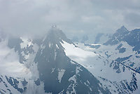 Clouds swirling around the summit of Mount Sefrit 7151 feet, 2180 meters, North Cascades National Park Washington USA